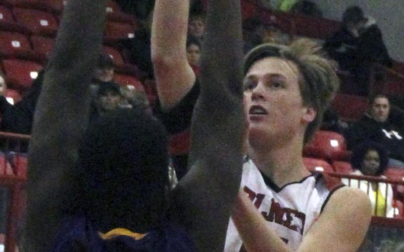 Olney High School senior guard Brent McCorkle sinks a jumper against Munday.