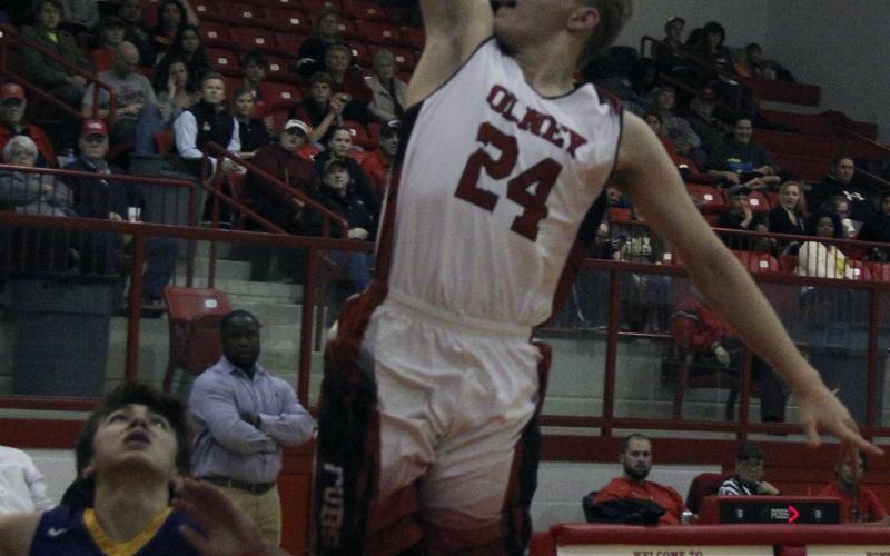 Olney High School senior guard Andrew Benhardt goes for a layup against Munday.