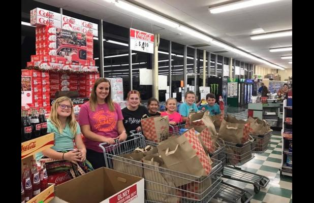 The Orth 4-H dropped by Stewart's Grocery to make a donation to the Olney Food Bank.