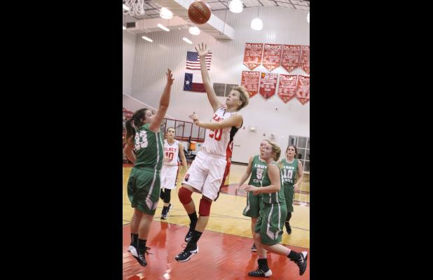 Olney senior guard Kodie Scott sinks a shot against Newcastle.
