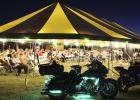 Hundreds gather Sunday for the first night of the Community-Wide Tent Revival, just off Main Street in Olney.